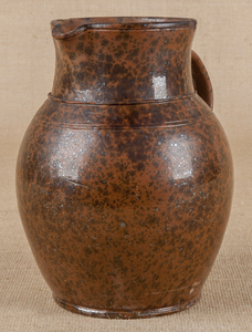 Redware pitcher, 19th c., with speckled manganesel