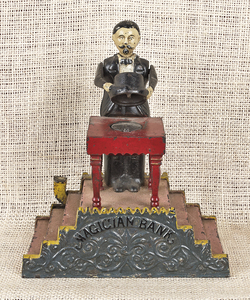 Cast iron Magician mechanical bank manufactured by