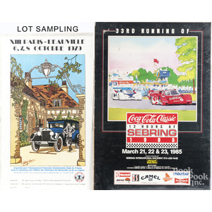 Group of unframed automobile posters.