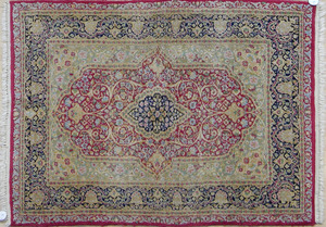 Pair of Kirman carpets, 5' x 3' 5