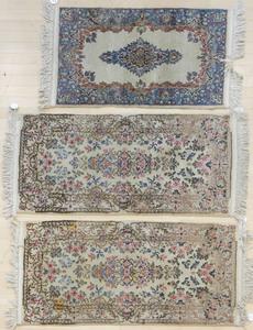 Three Kirman mats, 4' 4