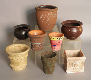 Eight redware crocks/flowerpots.