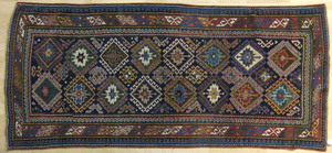 Kazak carpet, ca. 1900, with repeating medallionsn