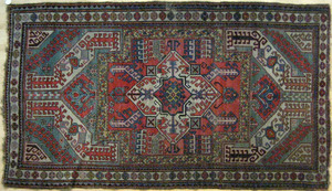 Kazak carpet, early 20th c., with central ivory me