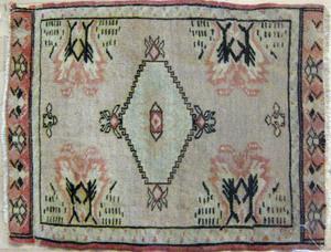 Three oriental mats, 1'9