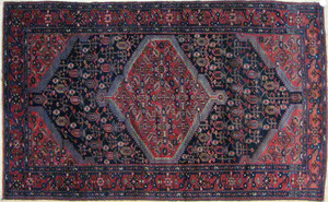 Malayer carpet, ca. 1930, with a central red medal