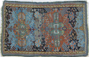 Kuba carpet, ca. 1890, with two medallions on a da