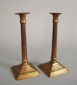 Pair of English bell metal columnar candlesticks,a