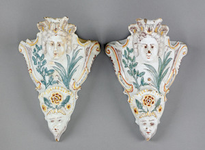 Pair of faience wall pockets, 19th c., with mask a