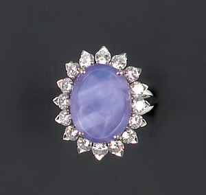 Sapphire and diamond ring in a platform setting co