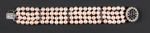 Pearl and sapphire bracelet with four strands of a