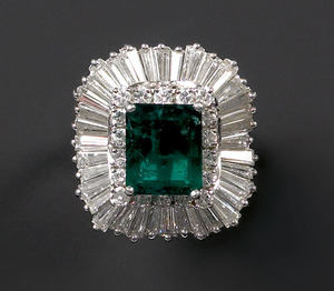 Emerald and diamond ring in a platinum setting wit