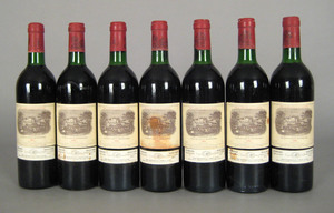 Seven 750ml bottles 1982 Lafite Rothschild.