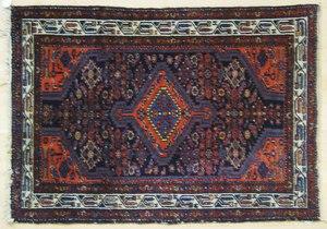 Three oriental throw rugs, 4'9