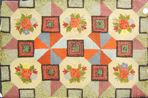 Hooked rug with floral decoration together with an