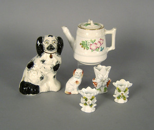 Two pottery spaniels, together with three miniatur