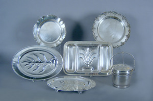 Four silver plated trays, together with an ice buc
