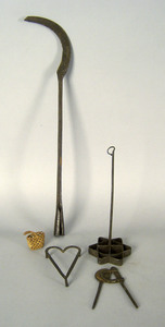 Wrought iron trivet, cutter, brand, and whaling to