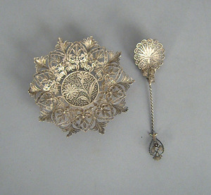 Silver filigree spoon and saucer, late 19th c.