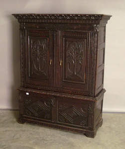 Jacobean style oak cupboard, 67