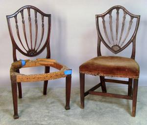 Two Hepplewhite mahogany shieldback dining chairs.