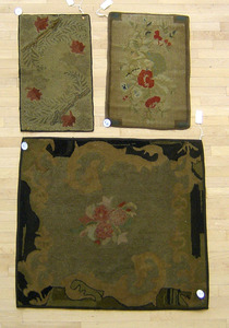 Three hooked rugs with floral decoration, early 20