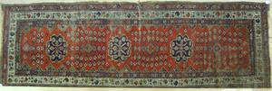 Kazak long rug, early 20th c., 11' x 4'.