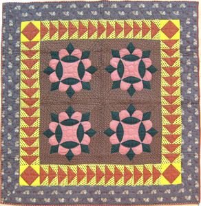 Pieced calico crib quilt with floral center and fl