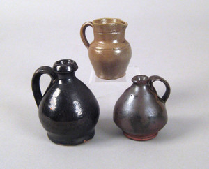 Two miniature redware jugs, late 19th c., 2 1/4