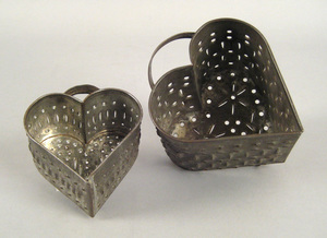 Two pierced heart form cheese molds, 19th c., 4 1/