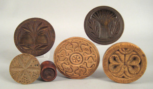 Six butterprints, 19th c., carved with sheaf of wh