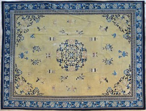 Roomsize Peking rug, late 19th c., with a floral m