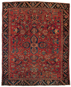 Roomsize Heriz rug, ca. 1920, with a central medal