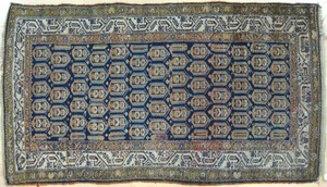 Hamadan throw rug, ca. 1920, with boteh designs on