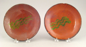 Two Pennsylvania redware pie plates, 19th c., with