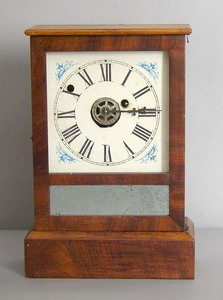 Waterbury mahogany shelf clock, 11 3/4