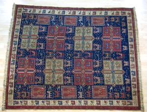Roomsize rug with akstata design, 10' x 8'.
