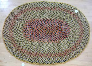 Three braided rugs.