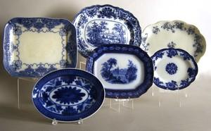 Six flow blue platters, largest 15