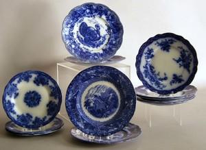 Twelve flow blue plates, 8-9