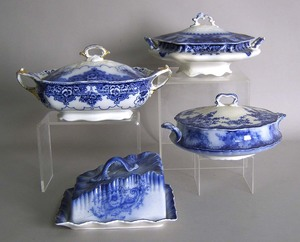 Three flow blue covered tureens, together with a b