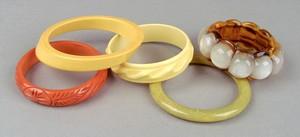 Four bakelite bangles to include 1 orange, 2 yello