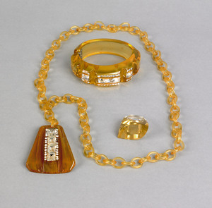 Lucite and bakelite amber colored matching necklac