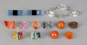 Seven Lucite rings, six in rainbow colors and onei