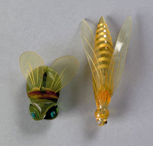 Two rare bakelite and lucite bug-form brooches, on