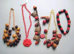 Three celluloid/plastic necklaces and a bracelet,
