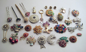 Rhinestone and colored stone brooches, some vintag