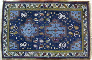 Shirvan throw rug, early 20th c., with 2 medallion