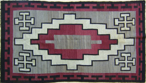 Navajo regional rug with stepped interior in red,l