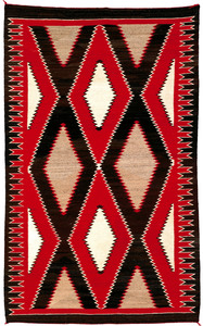 Vibrant Navajo regional rug in red, brown, and ivo